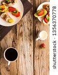 breakfast table with tasty... | Shutterstock . vector #1356370778