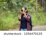photographer woman asian woman... | Shutterstock . vector #1356470135