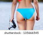 sexy woman fishing.  back view | Shutterstock . vector #135666545