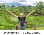 relaxed female traveler  arms...   Shutterstock . vector #1356703892
