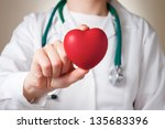 red heart in the hand of a... | Shutterstock . vector #135683396