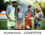 friends having a barbecue party ... | Shutterstock . vector #1356859358