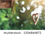 Stock photo shape wooden heart hanging on ceilng decorate in wedding ceremony valentine day concept 1356864872
