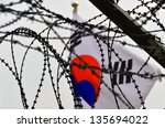 Fence And Flag At The Korean...