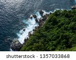 waves on beautiful sea rocky... | Shutterstock . vector #1357033868