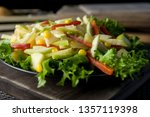 salad of radish  apples  sweet... | Shutterstock . vector #1357119398