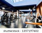 new fitness machines in modern... | Shutterstock . vector #1357197602