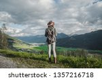 young woman in a hat in austria | Shutterstock . vector #1357216718