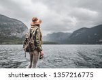 young woman in a hat by the lake | Shutterstock . vector #1357216775