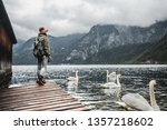 young tourist by the lake with... | Shutterstock . vector #1357218602