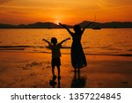a mother and son relax on the... | Shutterstock . vector #1357224845