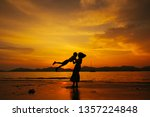 a mother and son playing on the ... | Shutterstock . vector #1357224848