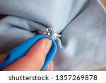 jeweller hand polishing and...   Shutterstock . vector #1357269878