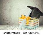 graduation mortarboard on book... | Shutterstock . vector #1357304348