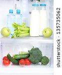 open refrigerator with...   Shutterstock . vector #135735062