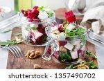 beet salad with arugula  goat... | Shutterstock . vector #1357490702