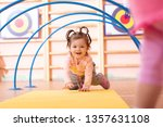 baby girl crawling on mat in... | Shutterstock . vector #1357631108