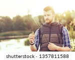 fisherman with a spinning and... | Shutterstock . vector #1357811588