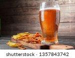 lager beer and snacks on wooden ...   Shutterstock . vector #1357843742