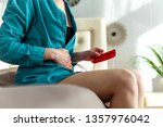 woman taking the medicine and...   Shutterstock . vector #1357976042