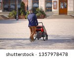 a young man with a child in a... | Shutterstock . vector #1357978478