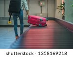 luggage reclaim at the airport... | Shutterstock . vector #1358169218