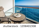 Champagne and caviar on balcony of cruise ship. - stock photo