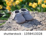 gray baby moccasins on rock... | Shutterstock . vector #1358413328