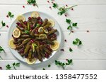 stuffed wine leaves. cherry and ... | Shutterstock . vector #1358477552
