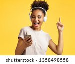 cheerful young girl in... | Shutterstock . vector #1358498558