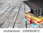 graduation mortarboard on  book ... | Shutterstock . vector #1358502872