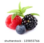 Fresh berries with mint - stock photo