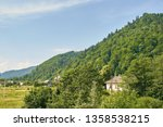 green mountains in the midst... | Shutterstock . vector #1358538215
