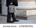 man wearing a suit  carrying a... | Shutterstock . vector #1358585582