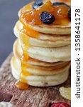 golden pancakes with raisins... | Shutterstock . vector #1358641178