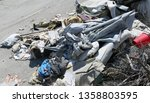 pile of rags and garbage in a... | Shutterstock . vector #1358803595