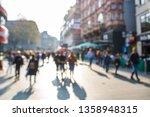 defocussed busy street scene in ... | Shutterstock . vector #1358948315