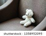 white teddy bear doll toy sit...   Shutterstock . vector #1358952095