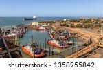 Small photo of Port Hedland, Australia - Feb 22 2017: Bulk Carriers entering and loading iron ore in the harbor. Port Hedland is the larges port by tonnage in Australia.