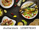 Stock photo mediterranean food smoked herring fish served with green onion lemon chili pepper lettuce 1358978345