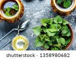 cup of healthy herbal tea with... | Shutterstock . vector #1358980682