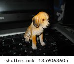 Figurine Of A Dog On The...