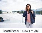 cheerful indian student girl... | Shutterstock . vector #1359174902