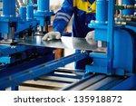 sheet of metal and hands of... | Shutterstock . vector #135918872