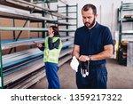 warehouse worker wearing blue... | Shutterstock . vector #1359217322