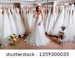 female trying on wedding dress... | Shutterstock . vector #1359300035