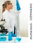 young woman scientist working... | Shutterstock . vector #1359446342
