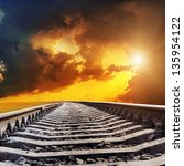 dramatic sunset over railroad - stock photo