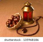 Small photo of Ramadan lamp and dates still life