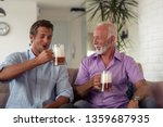 father and son drink beers and... | Shutterstock . vector #1359687935